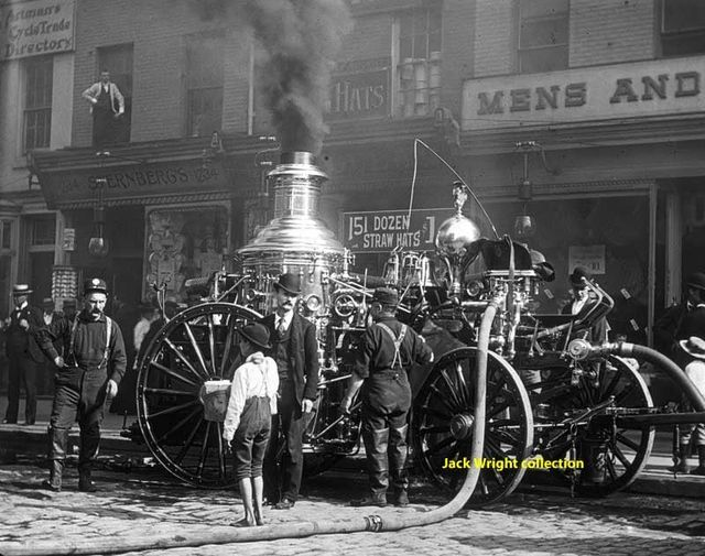 Engine 32 operating their 1888 Silsby second size steamer on a fire ground somewhere in Center City.